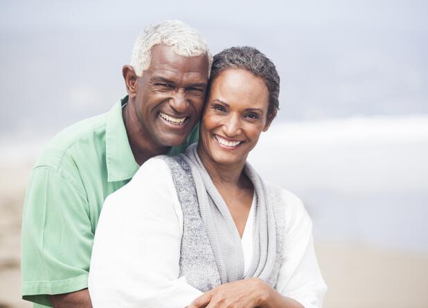 couple on beach smiling