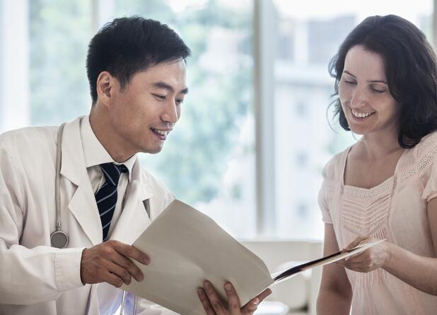 Doctor and patient discussing medical record in the hospital