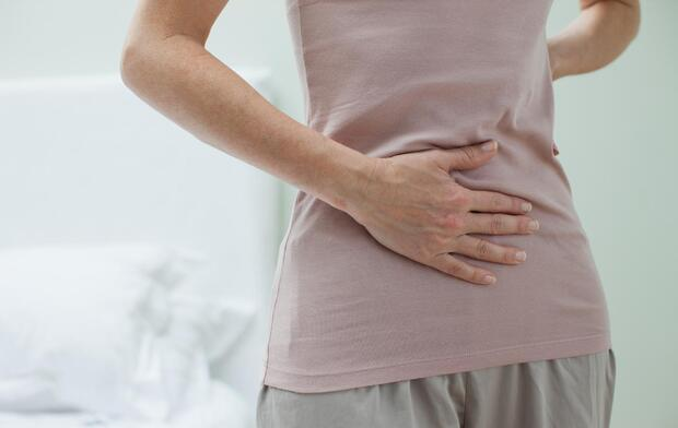 woman-rubbing-aching-stomach