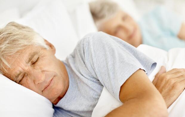Senior man and woman sleeping