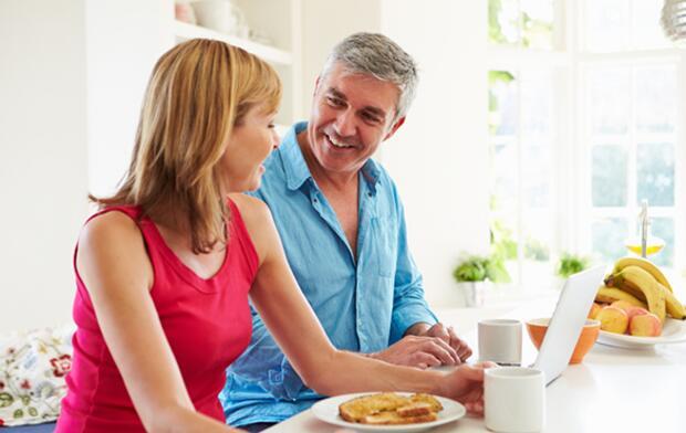 happy couple eating breakfast