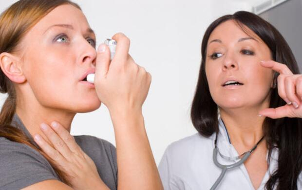 woman using inhaler with doctor, asthma