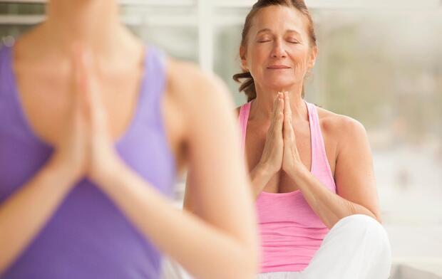 senior woman meditation in yoga class