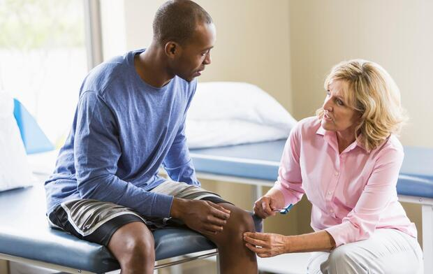 man-having-knee-checked-out-by-doctor