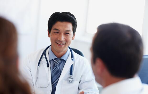 Doctor with couple in office