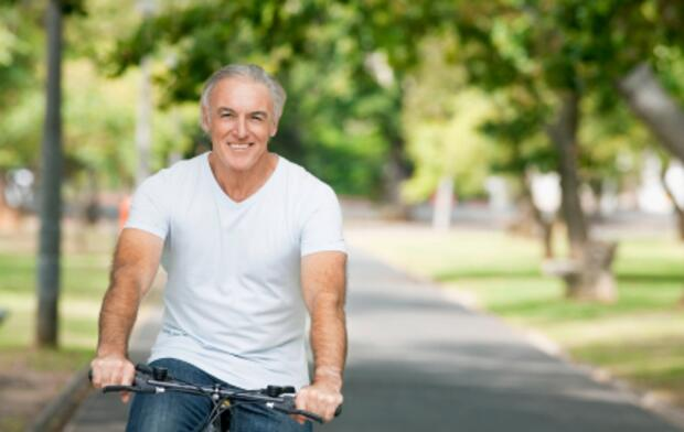 senior male riding bike