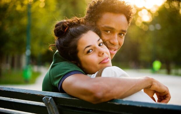 interracial couple on park bench