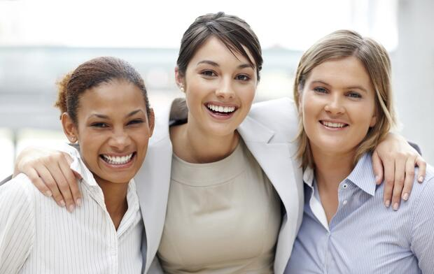 Portrait of smiling business women standing together