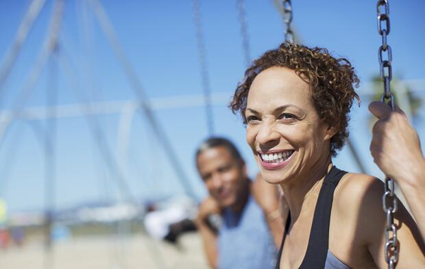 woman-outside-on-swingset